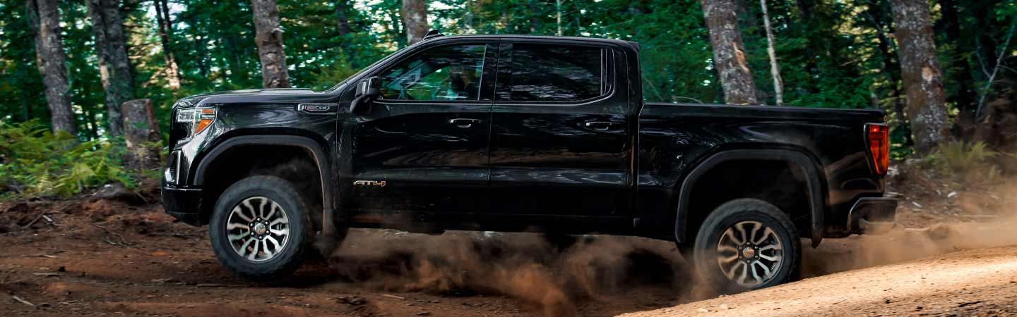 Side view of a black 2020 GMC Sierra 1500 in motion