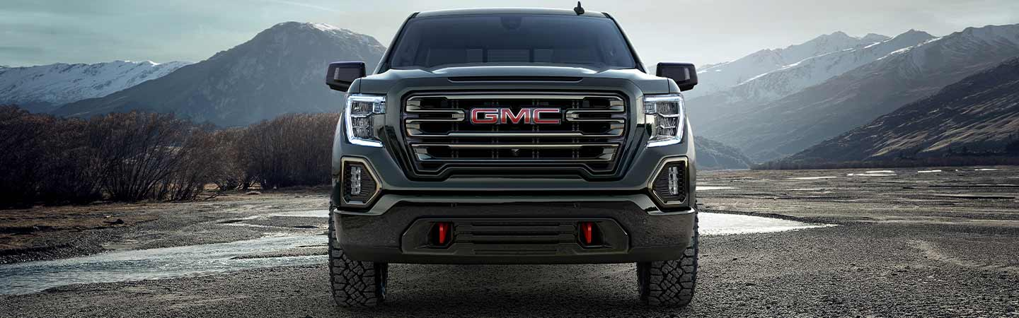 Front grille of the 2020 GMC Sierra 1500 in motion
