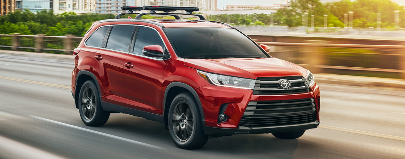 2019 Toyota Highlander Exterior in Red - Driving on the road.