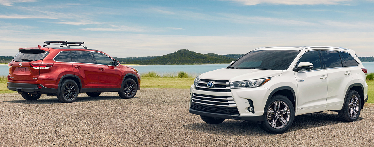 Pair 2019 Toyota Highlander Exterior - Parked in a gravel lot near water.
