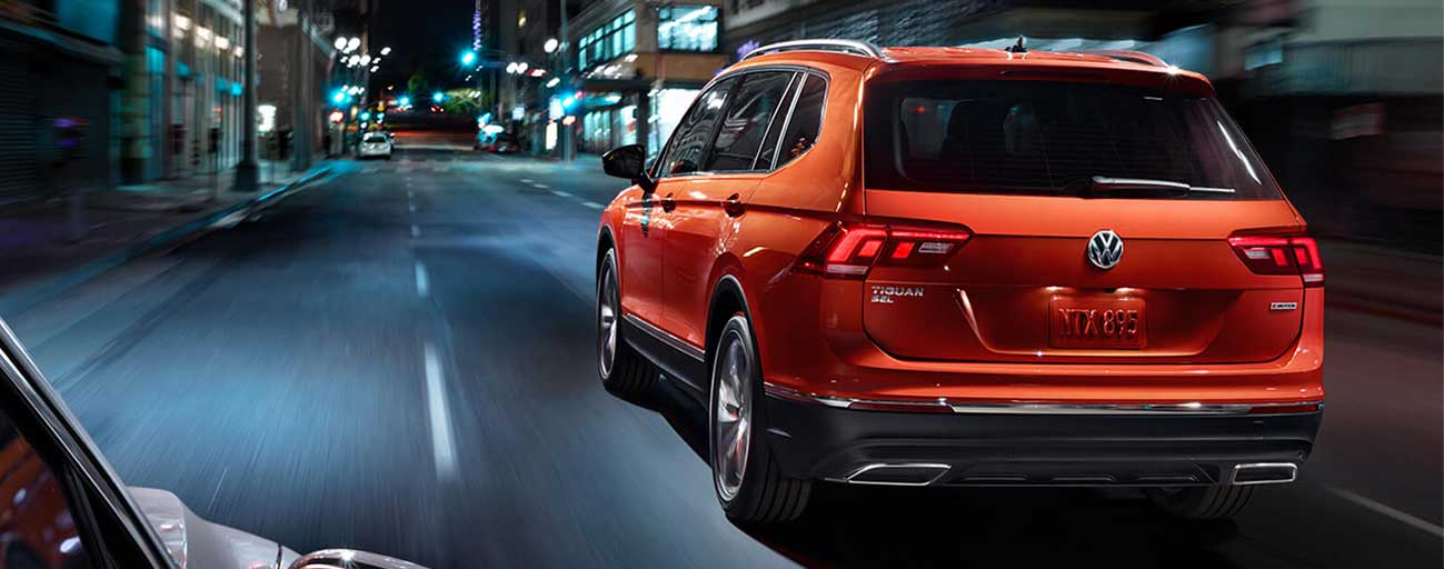 2019 Volkswagen Tiguan rear view driving.
