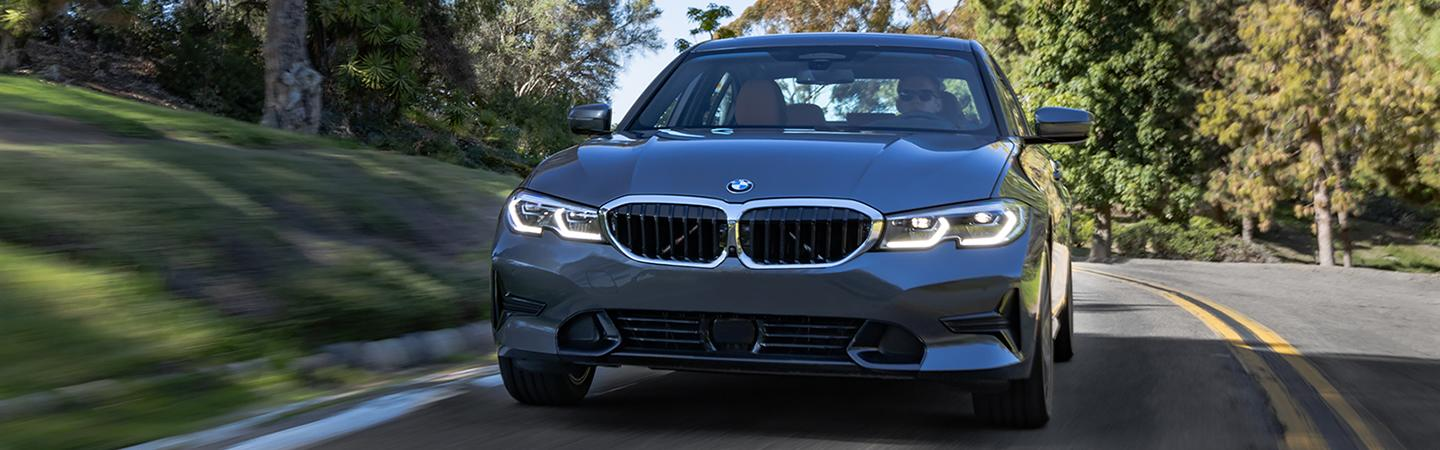 Blue 2020 BMW 3 Series in motion