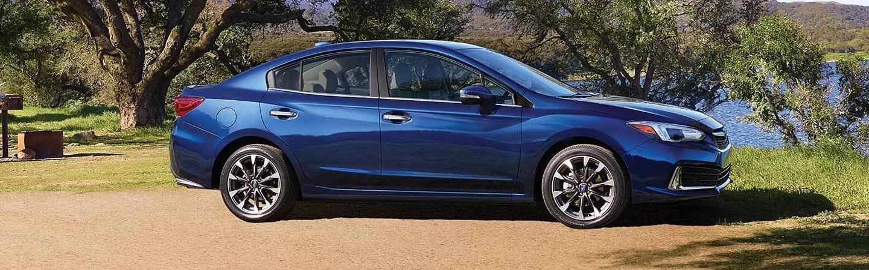 Blue 2020 Subaru Impreza parked
