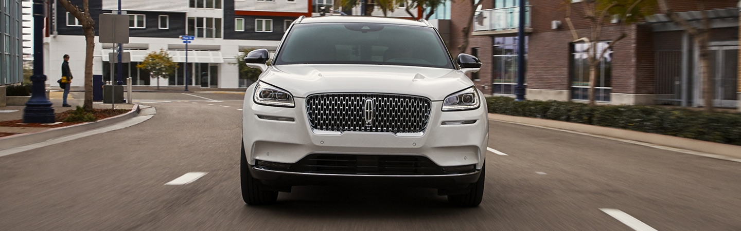 Front view of the 2020 Lincoln Corsair driving through Wilkes-Barre, PA