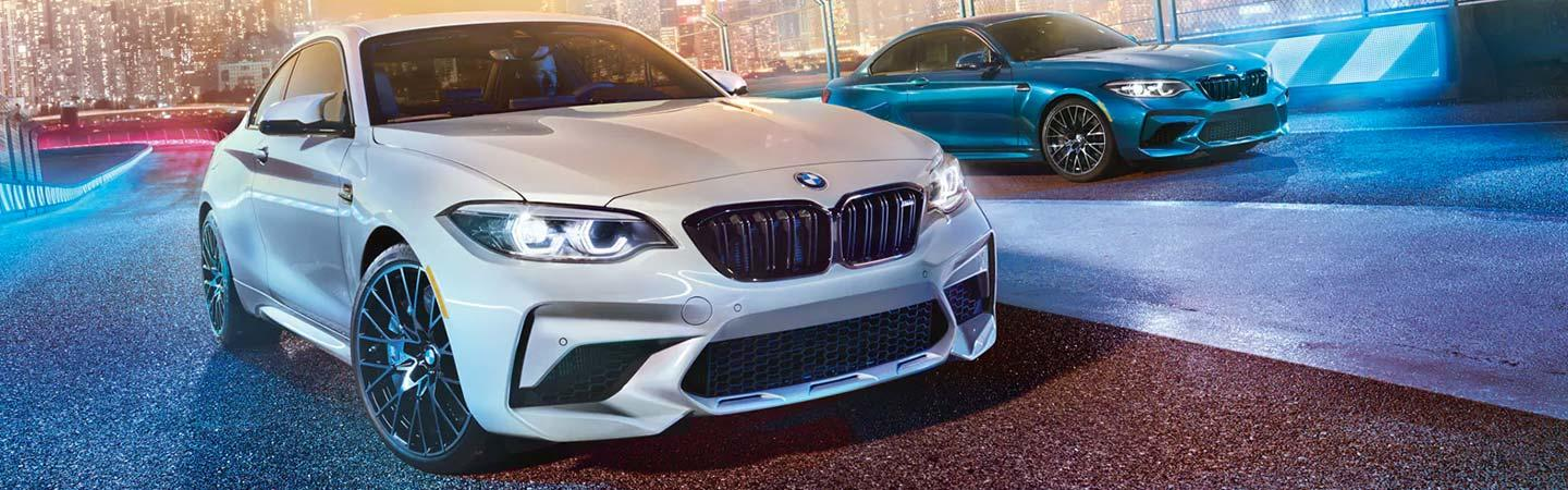 Two 2020 BMW 2 Series vehicles driving next to each other