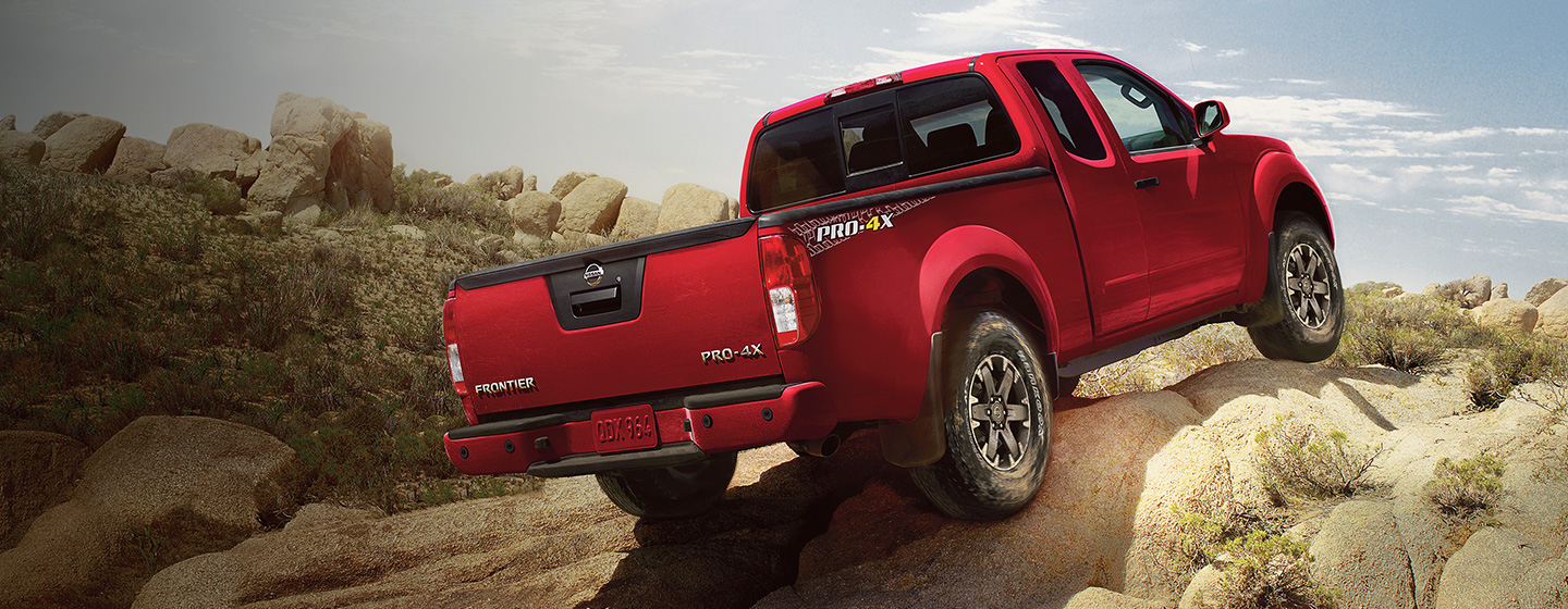Nissan Frontier driving on rocks