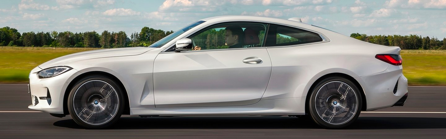 White 2021 BMW 4 Series Coupe Driving on Highway