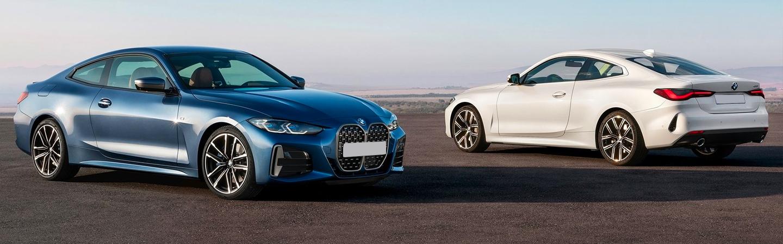 Blue 2021 BMW 4 Series next to White 2021 BMW 4 Series