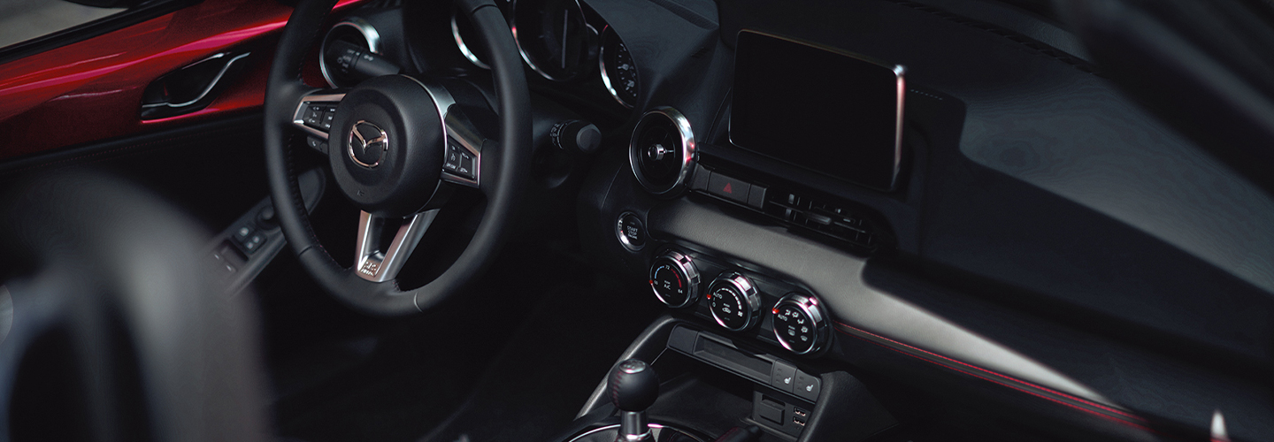 Side view of the interior drivers side perspective of the 2019 Mazda Miata
