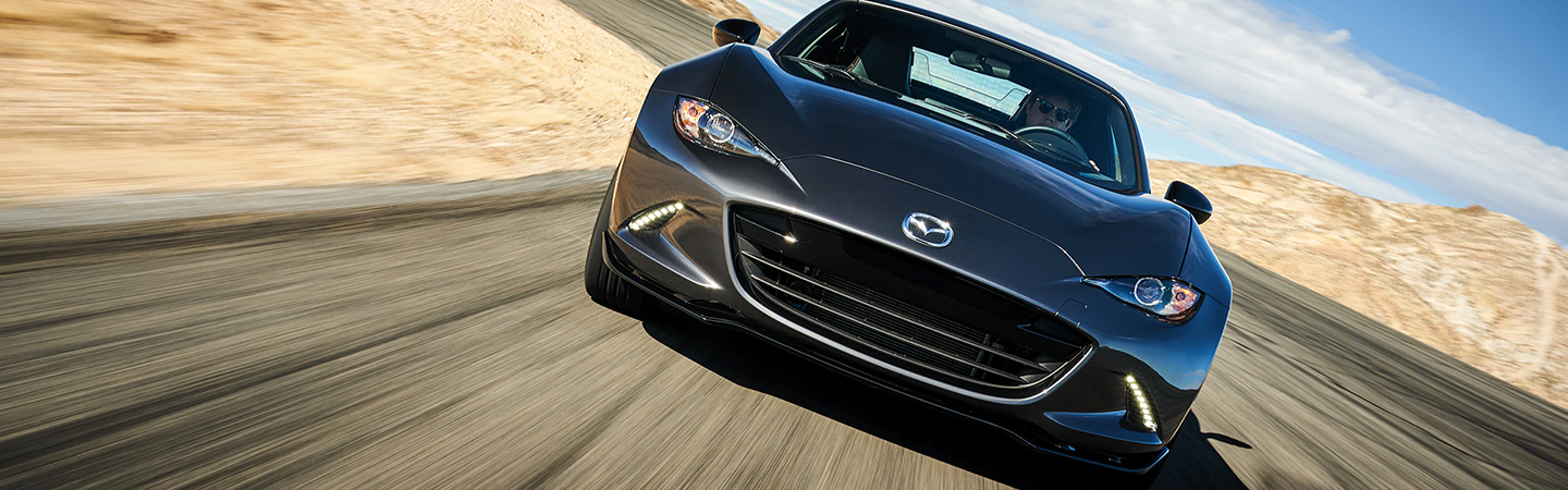 Front view of the 2019 Mazda Miata in motion