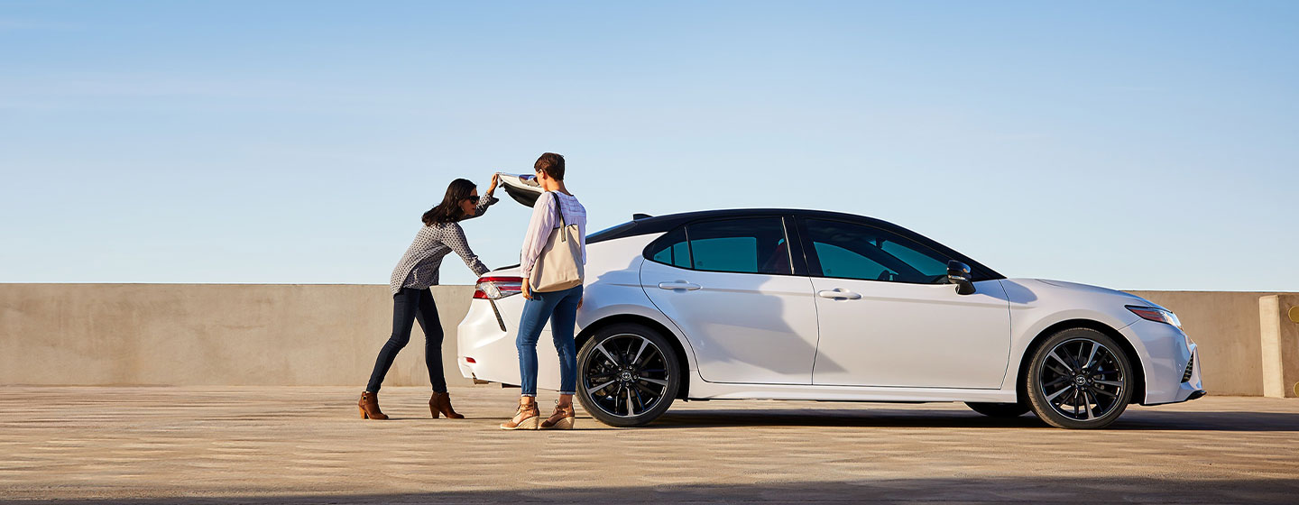 2019 Toyota Camry Exterior - People getting items from the trunk.