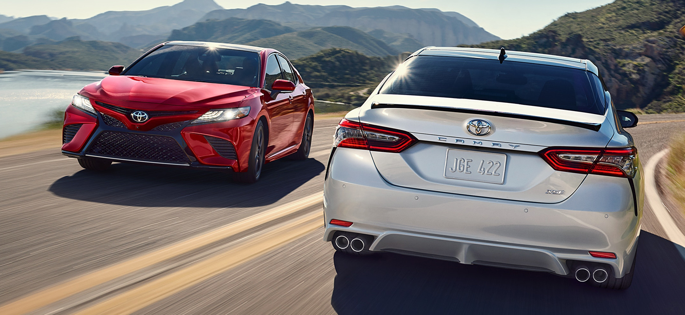 Pair of 2019 Toyota Camry Vehicles Driving on the road.