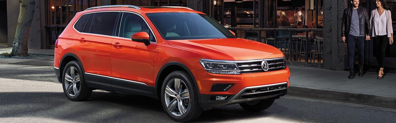 2019 Volkswagen Tiguan - Orange - Parked in front of a store