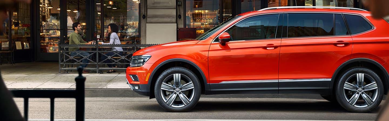 2019 Volkswagen Tiguan - Orange - Side view - Parked
