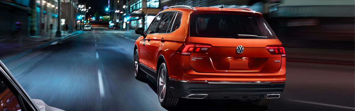 2019 Volkswagen Tiguan - Orange - Rear View - Driving on the road at night