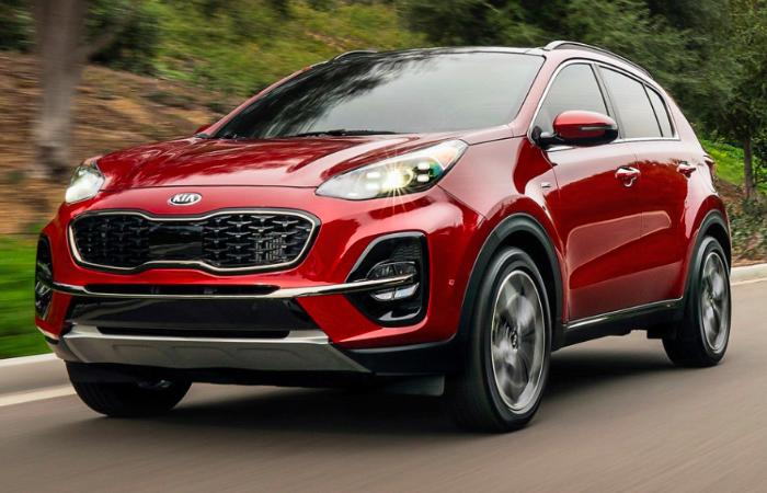 Red 2021 Kia Sportage in motion