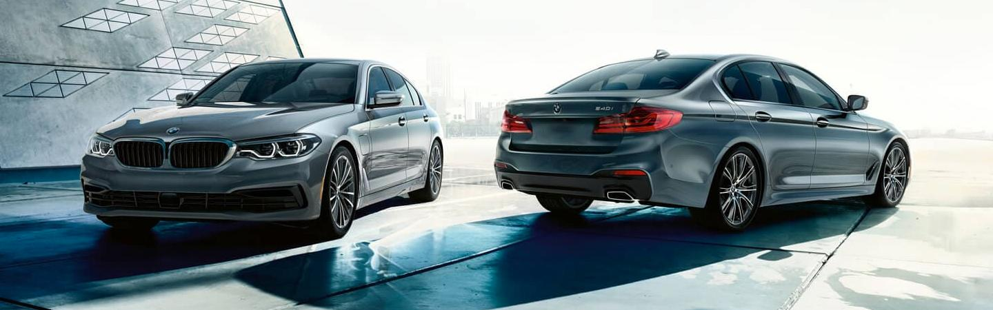Two 2020 BMW 5 Series vehicles parked together