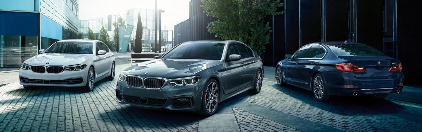 Many 2020 BMW 5 Series vehicles parked together