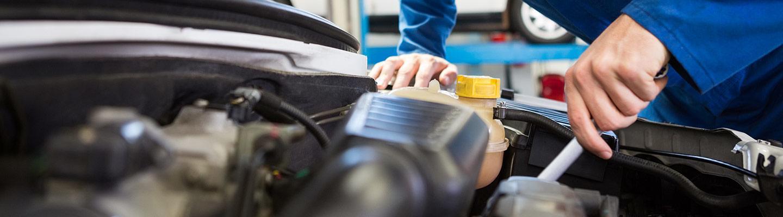 Acura technician work on a new Acura engine repair