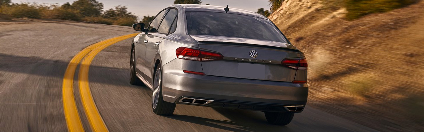 Rear view of the 2020 Volkswagen Passat driving up hill