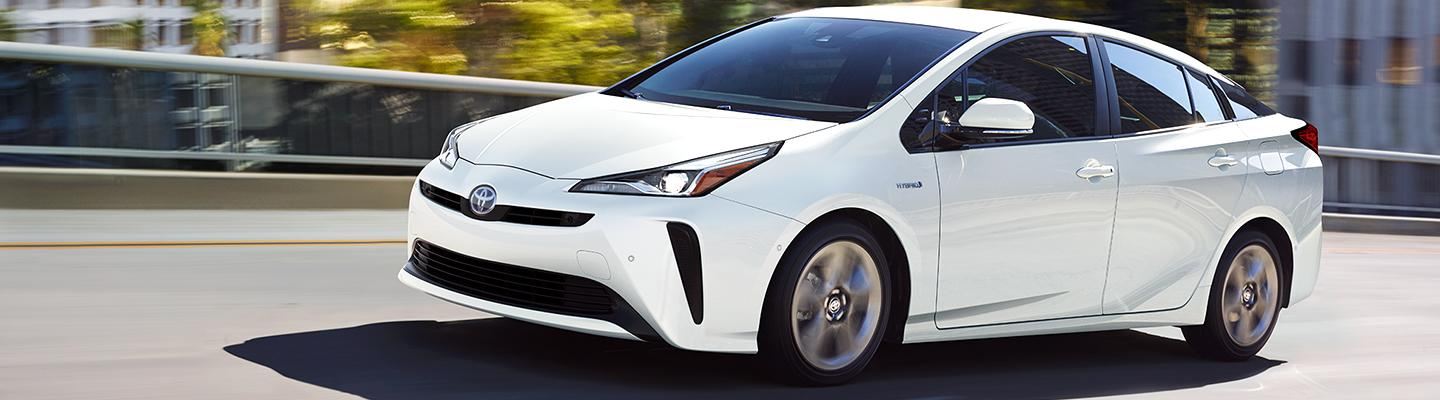 White 2021 Toyota Prius in motion