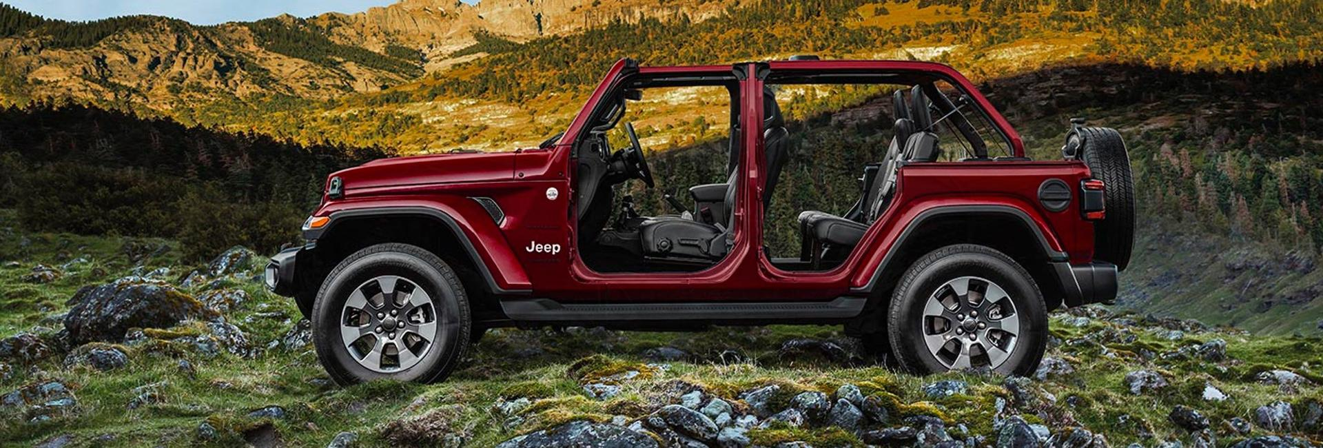 The 2021 Jeep Wrangler without doors on a mountain trail