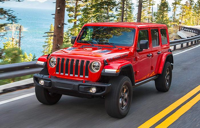 2021 Jeep Wrangler in motion near the ocean