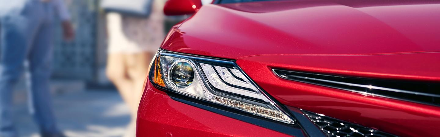 Upclose of Headlight of Red 2020 Toyota Camry