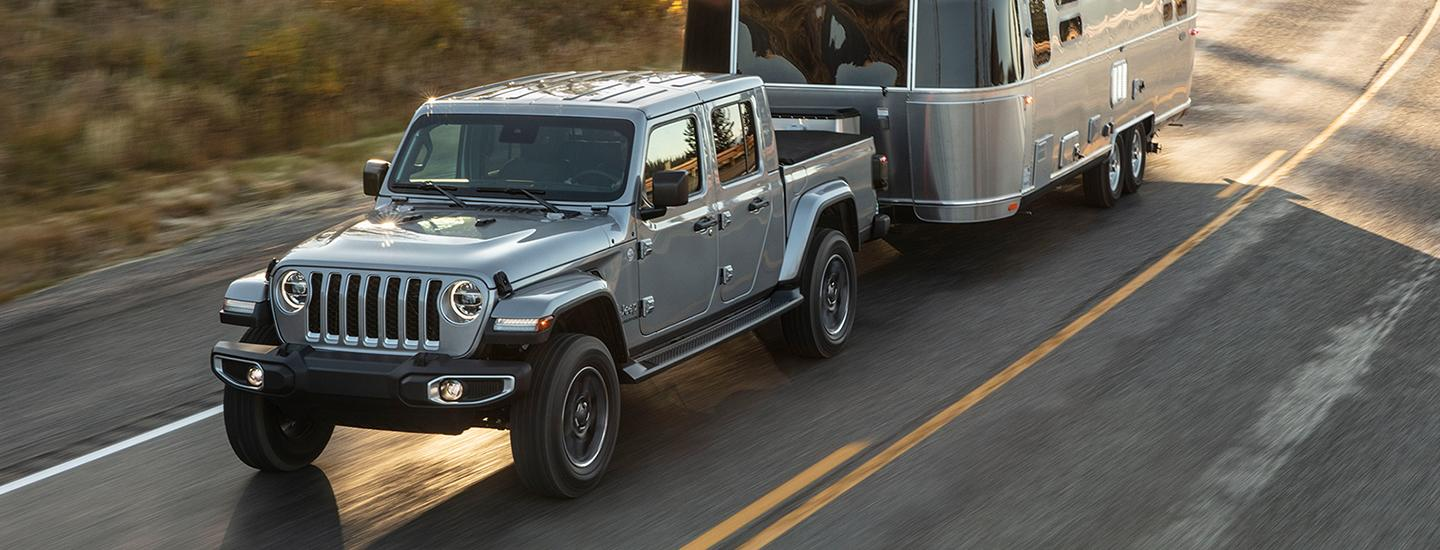 2020 Jeep Gladiator towing a trailer in motion outside of Central Florida CDJR