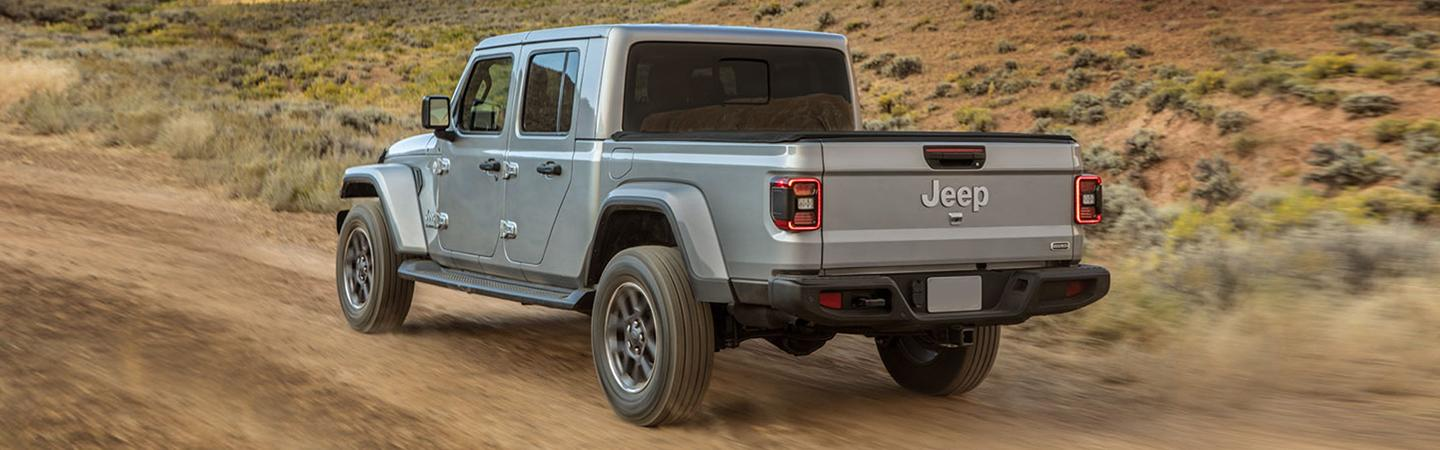 Rear view of the 2020 Jeep Gladiator in motion outside