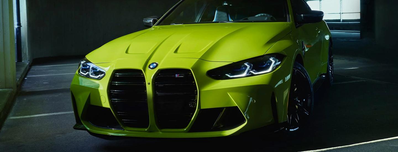 Neon Green 2021 BMW M4 Parked in Parking Garage
