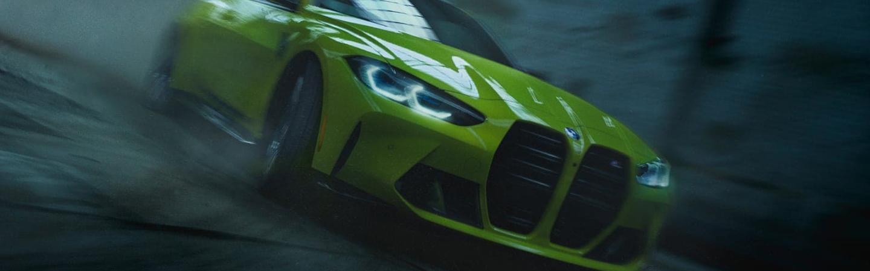 Green 2021 BMW M4 driving at night