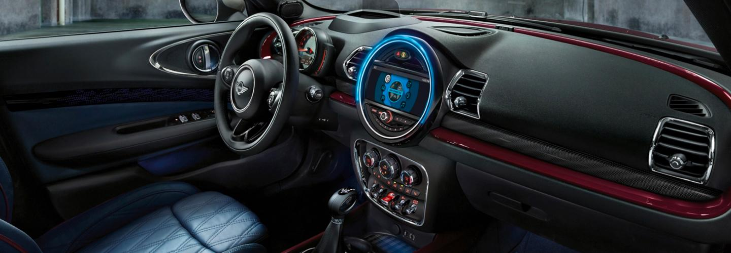 Passenger's side view of a MINI Cooper Clubman's steering wheel and dashboard