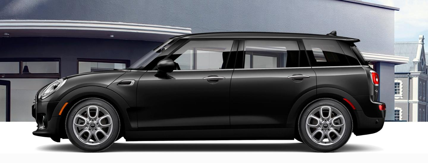 Side profile of a parked black MINI Cooper Clubman
