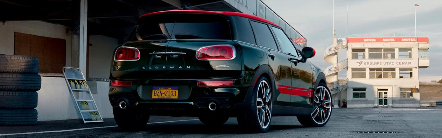 Rear view of a parked black and red MINI Cooper Clubman