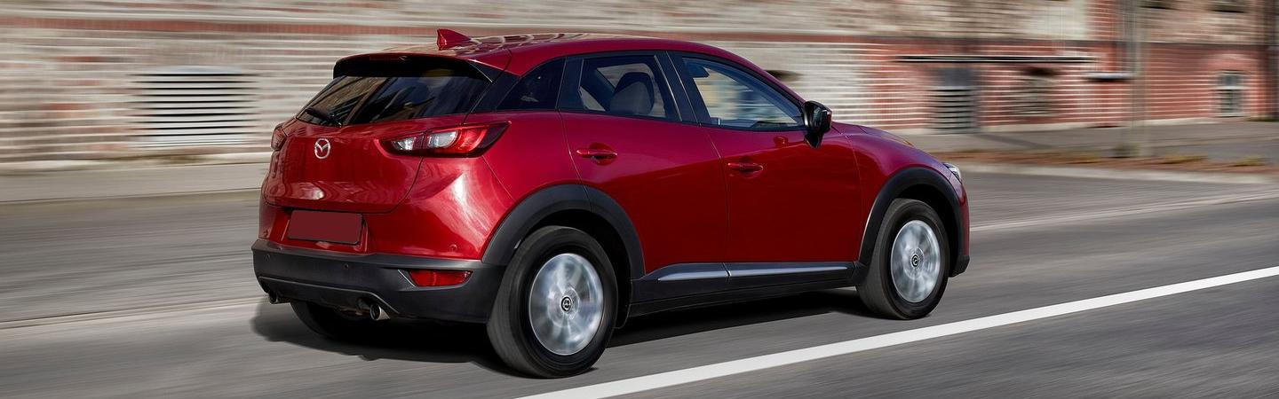 Rear view of the 2019 Mazda CX-3 in motion available at Naples Mazda