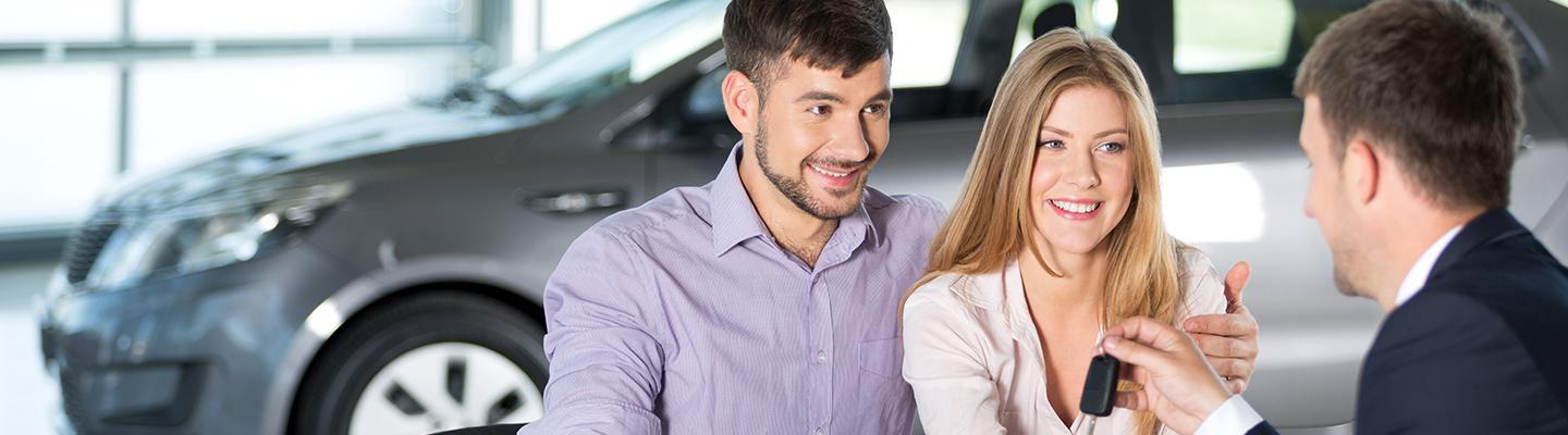 Salesperson talking to couple