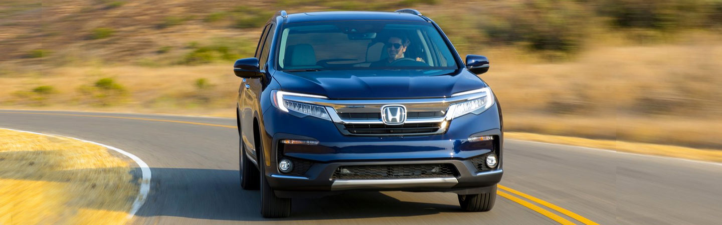 Front of the 2019 Honda Pilot in motion, available at our Honda dealership