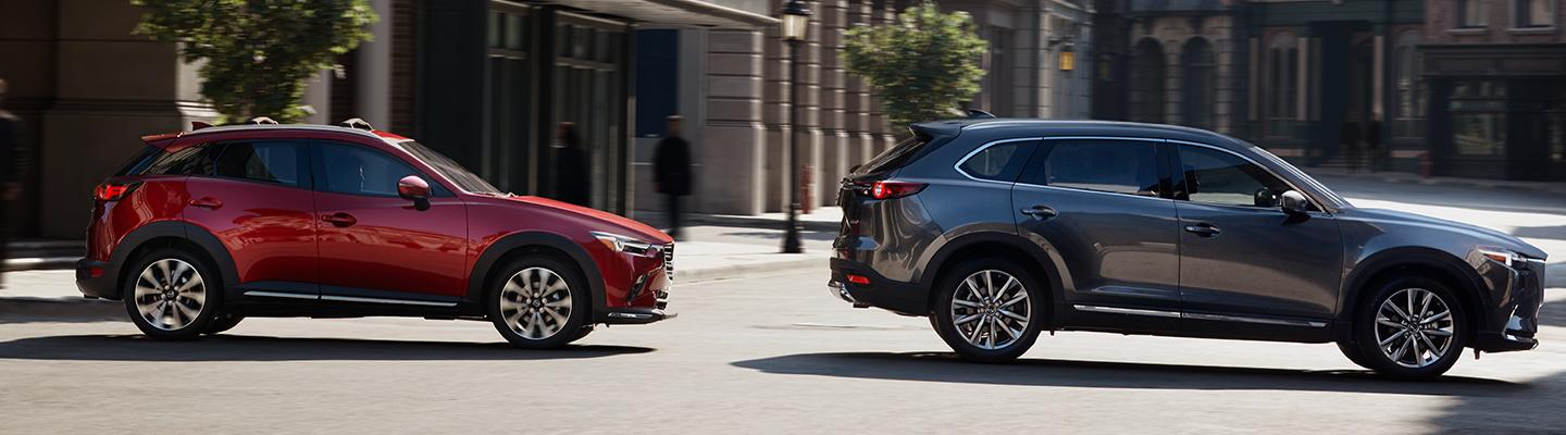 Two 2019 Mazda CX-3 vehicles driving together down the road