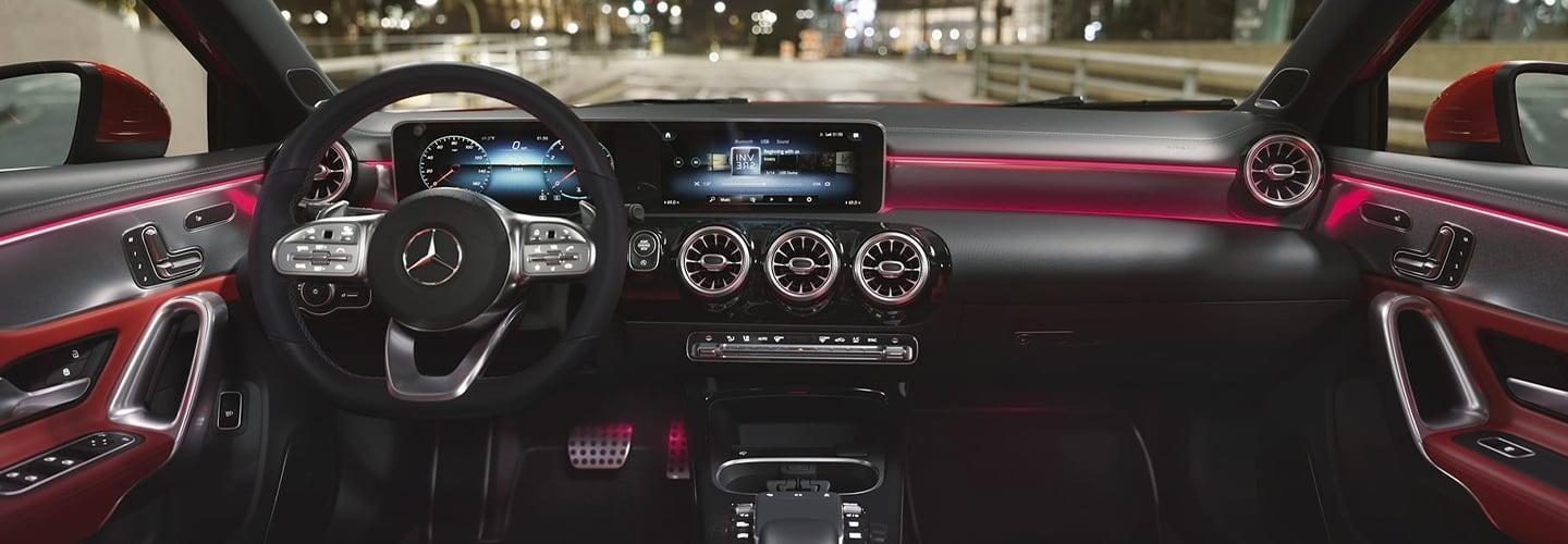 Red and Black Leather Steering Wheel and Inside Dashboard view of a 2021 Mercedes-Benz A-Class