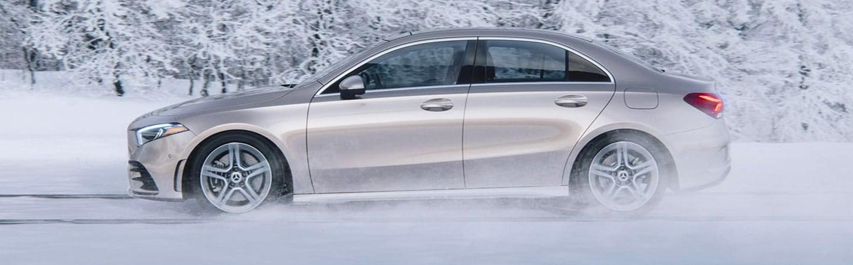 Silver 2021 Mercedes-Benz A-Class Driving Through Snow