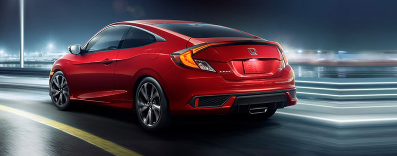 2019 Honda Civic rear view driving in the city