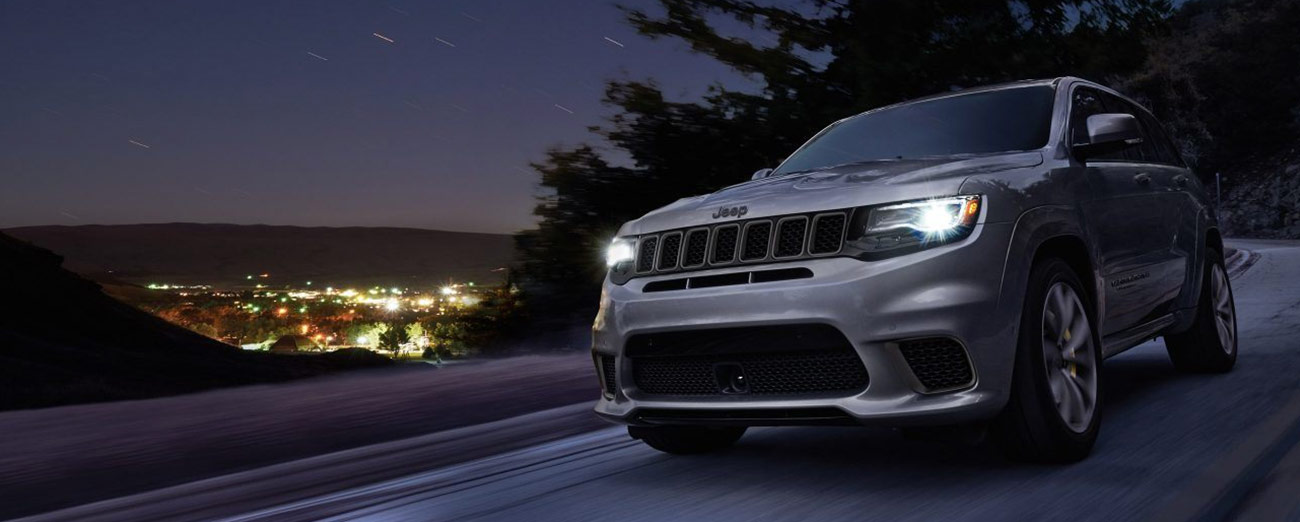Jeep Grand Cherokee on a mountain at night