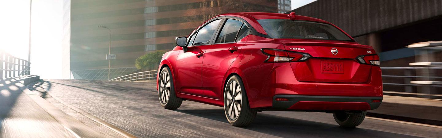 Red 2020 Nissan Versa in motion