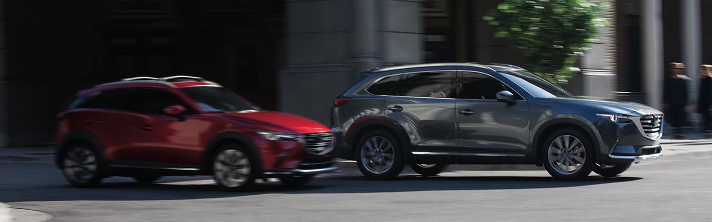 Two 2019 Mazda CX-9 vehicles in motion