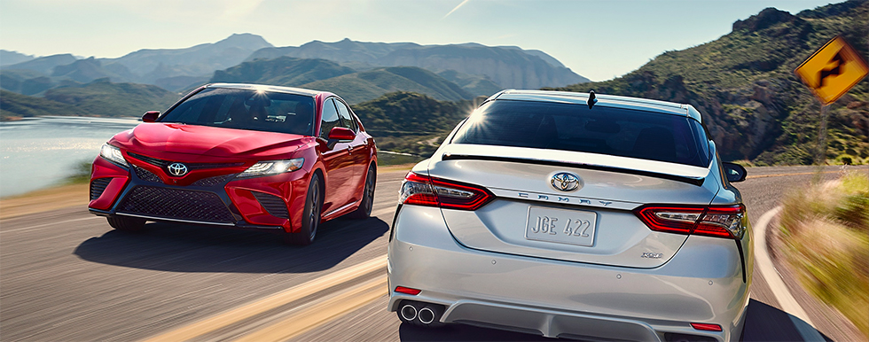 Pair of 2019 Toyota Camry Exterior - Driving on the road.