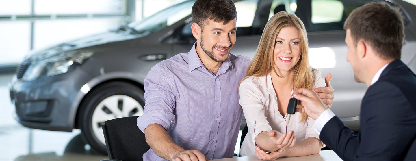 Couple getting auto financing at Gainesville Buick GMC in Jacksonville, FL
