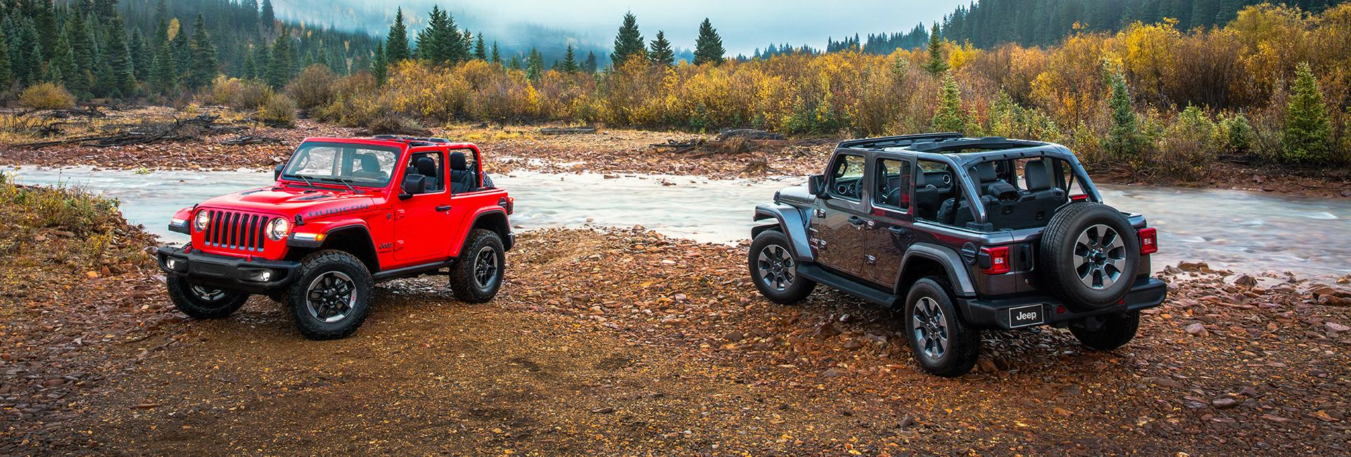 Two 2021 Wranglers parked near a creek