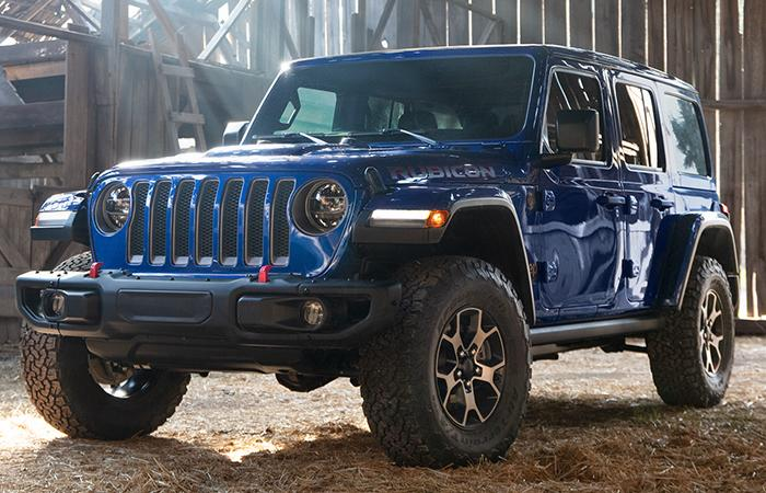 Blue 2021 Jeep Wrangler parked in a barn