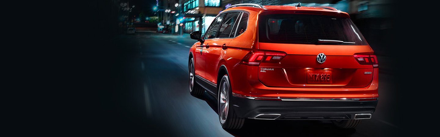 Rear of the 2019 Volkswagen Tiguan in motion available at Volkswagen of Gainesville